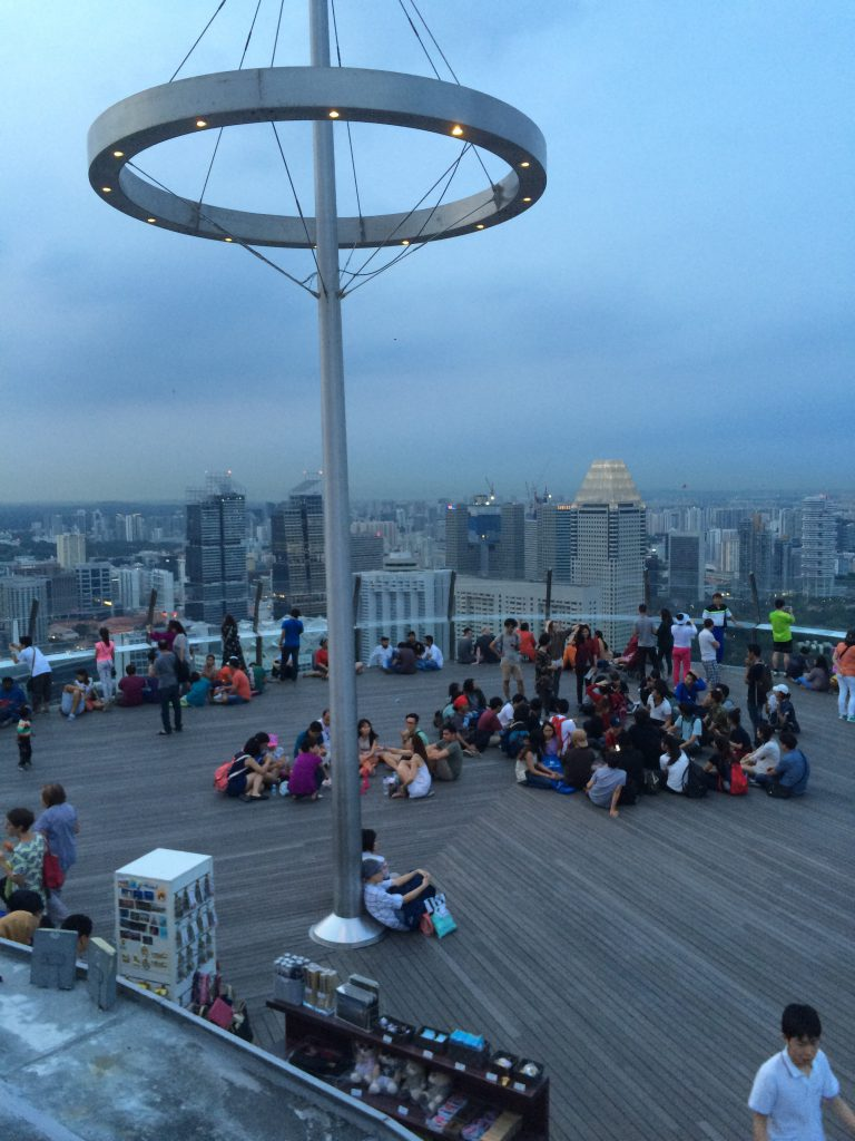 a picture of tourists sitting on a rooftop