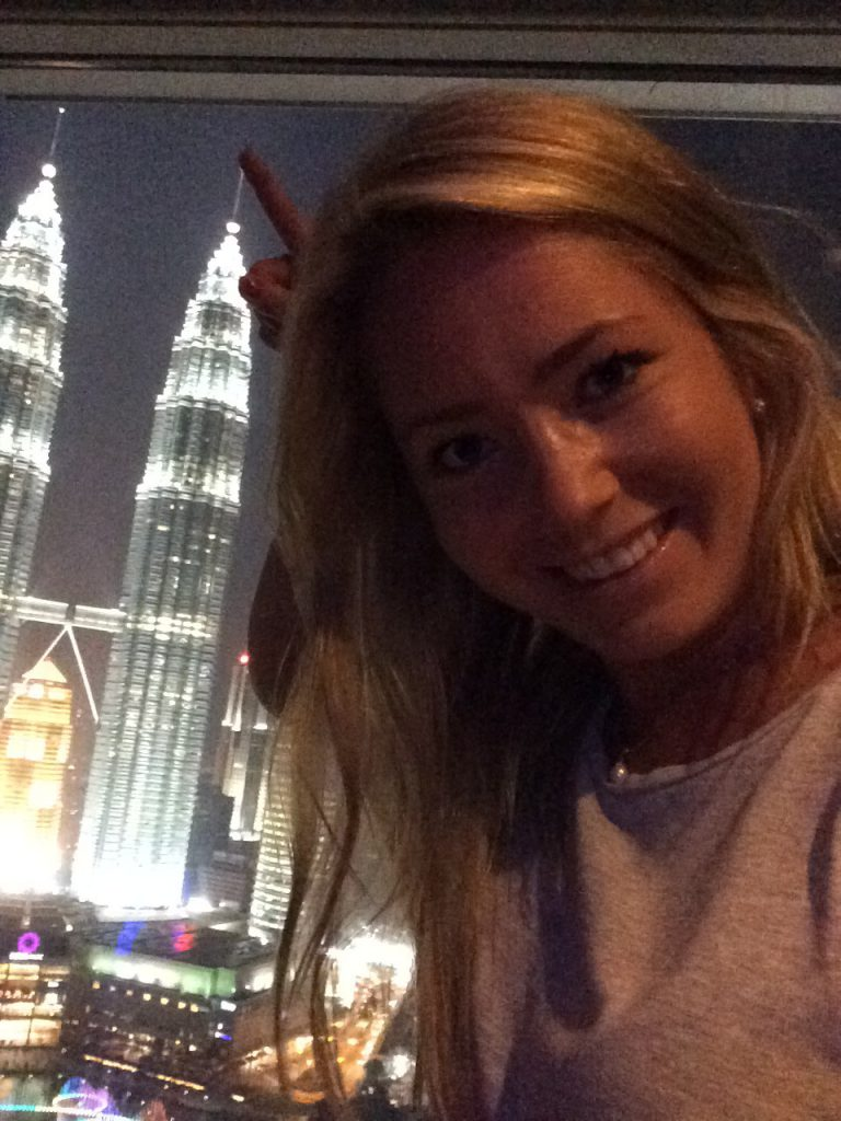 a picture of me at twin towers in Malaysia