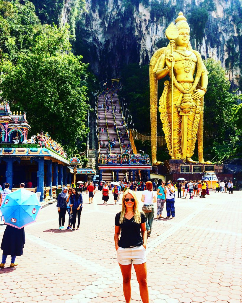me at the entrance of the steps to Batu caves in Malaysia