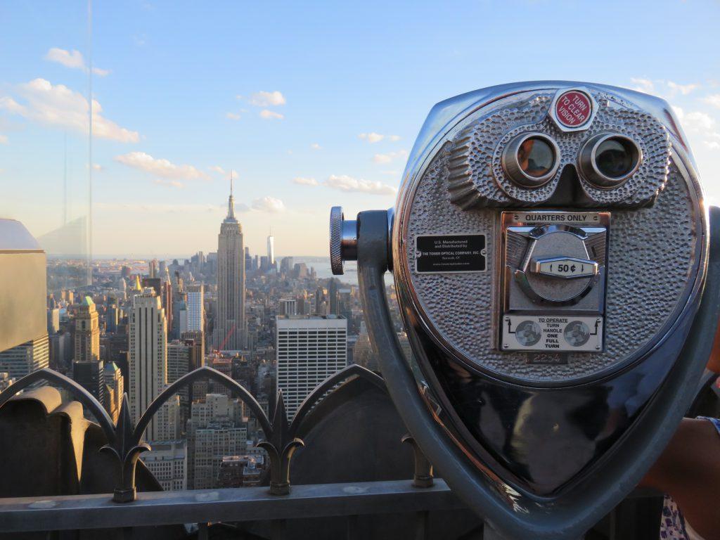 paid binoculars to view the city