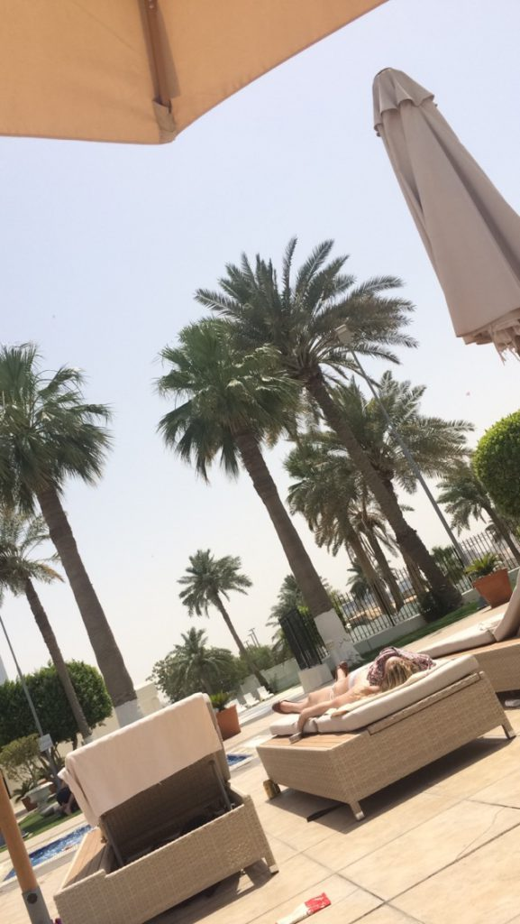 people sleeping by the pool at the marriott in doha