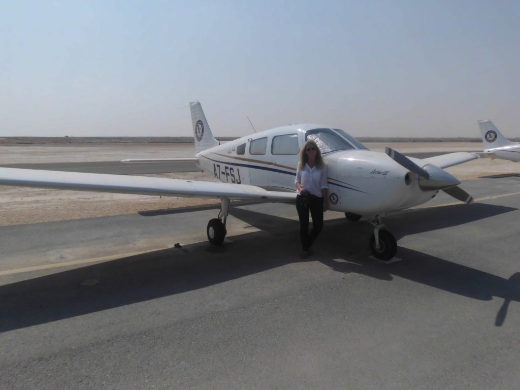 me in front of a small plane