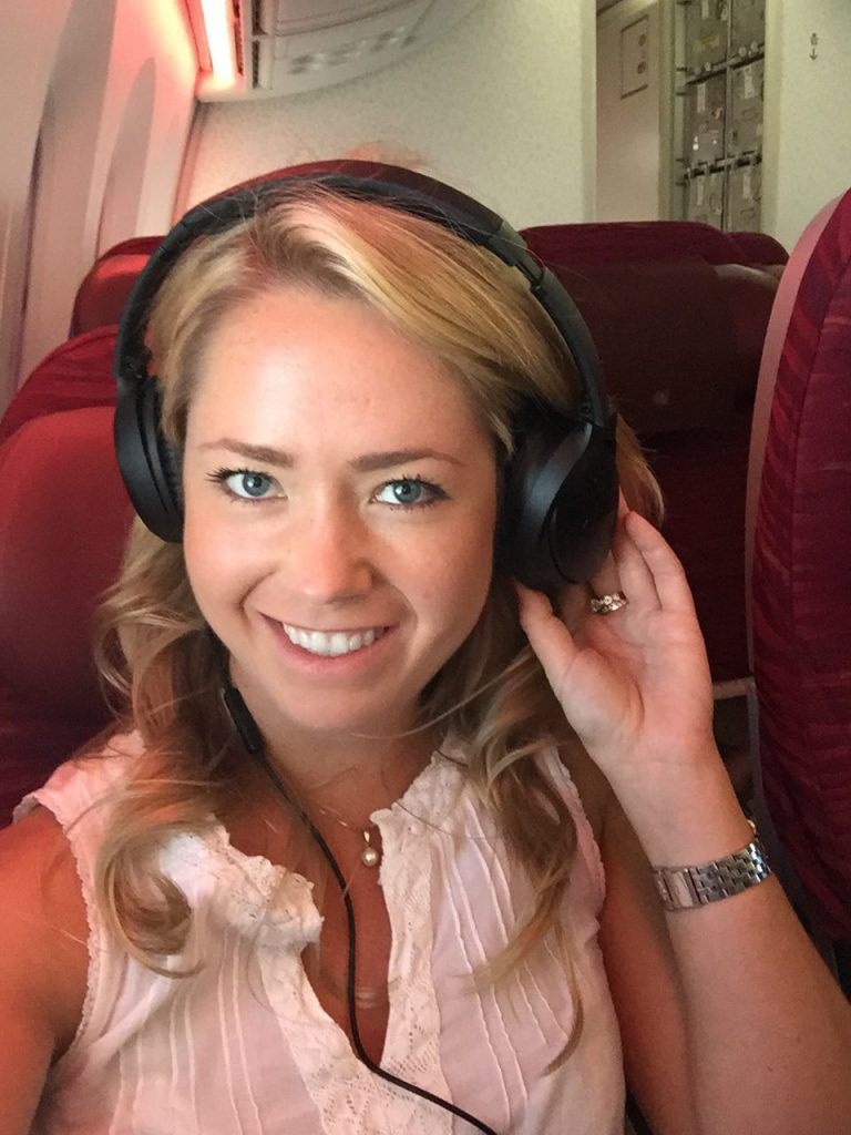 me wearing head phones on a plane to avoid fear of flying