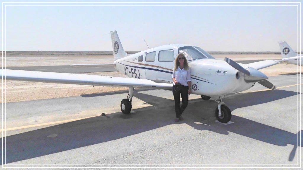 me standing in front of a small plane