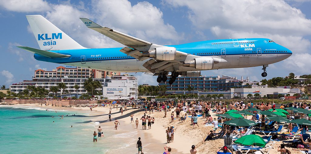 KLM flight landing over the beach