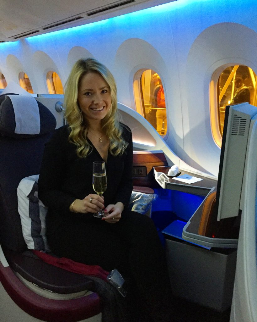 A picture of me having wine before I travel on Qatar airways