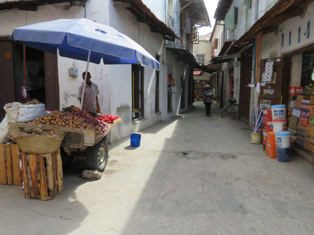 a street and vegetable seller
