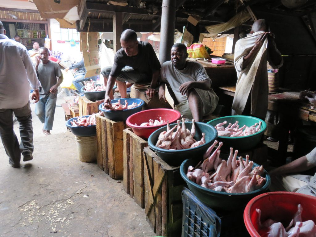 meat stall with chickens on display