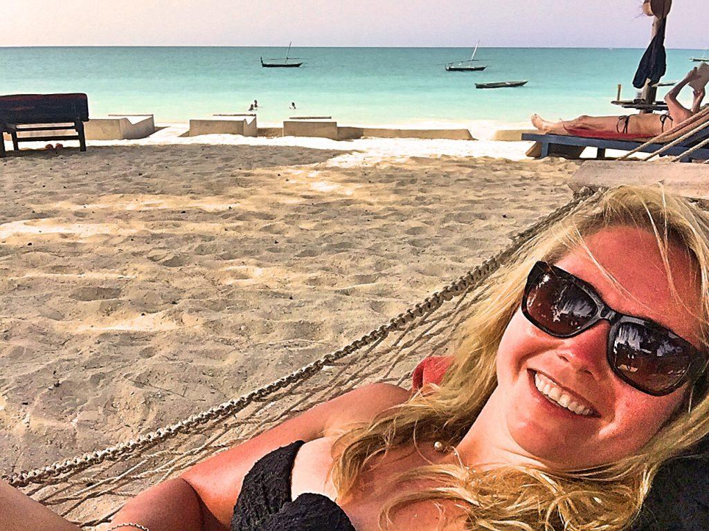 A selfie of me on a hammock on a beach