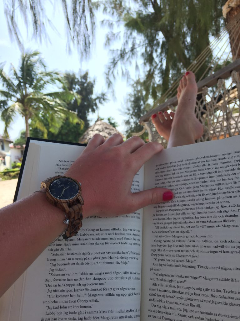 a picture of me wearing the watch and reading a book