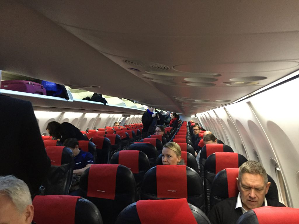 a picture of passengers seated in the airplane