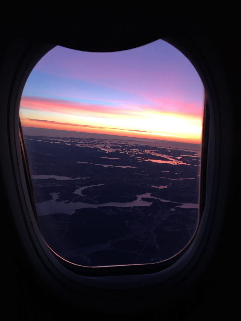 a picture of the sunset through my window on my flight