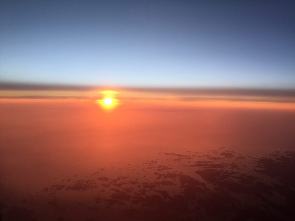 a picture of sunrise from the plane