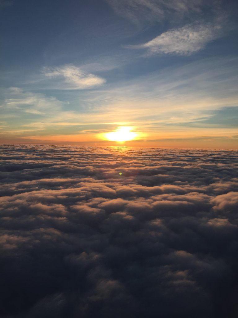 a picture of the sunrise with clouds