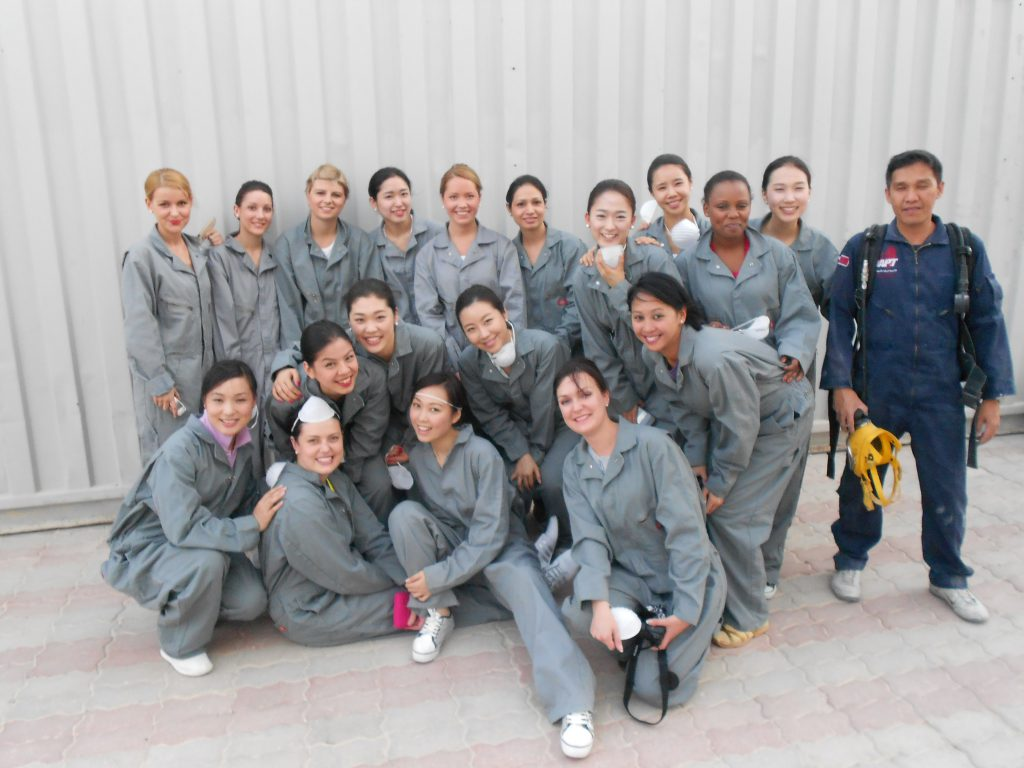 a picture of our team with the trainer at the flight attendant school