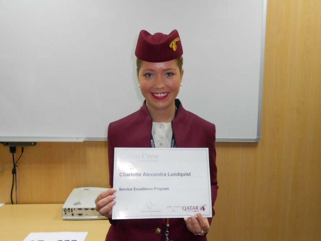 a picture of me holding my certificate