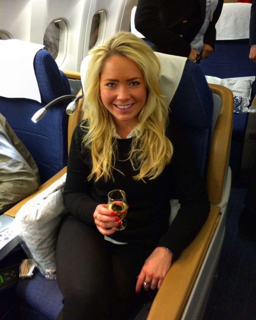 a picture of me having wine in business class