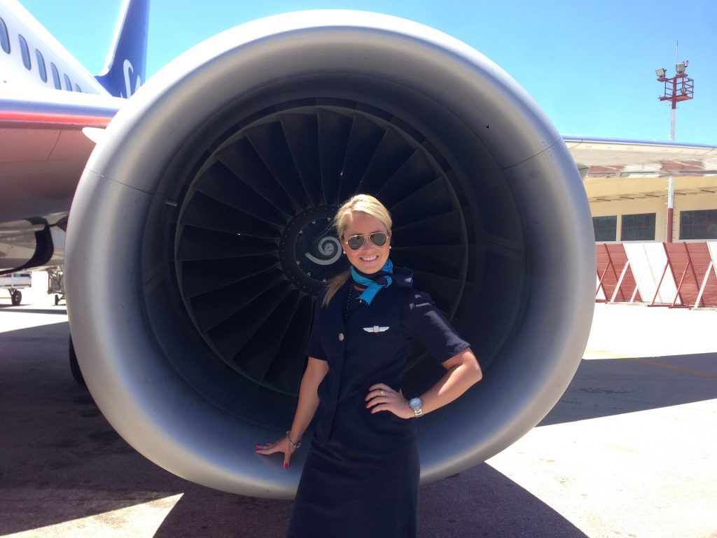 a picture of me standing beside the engine of the aircraft