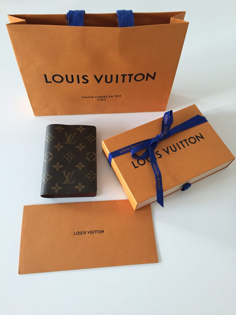 a picture of Louis Vuitton passport cover