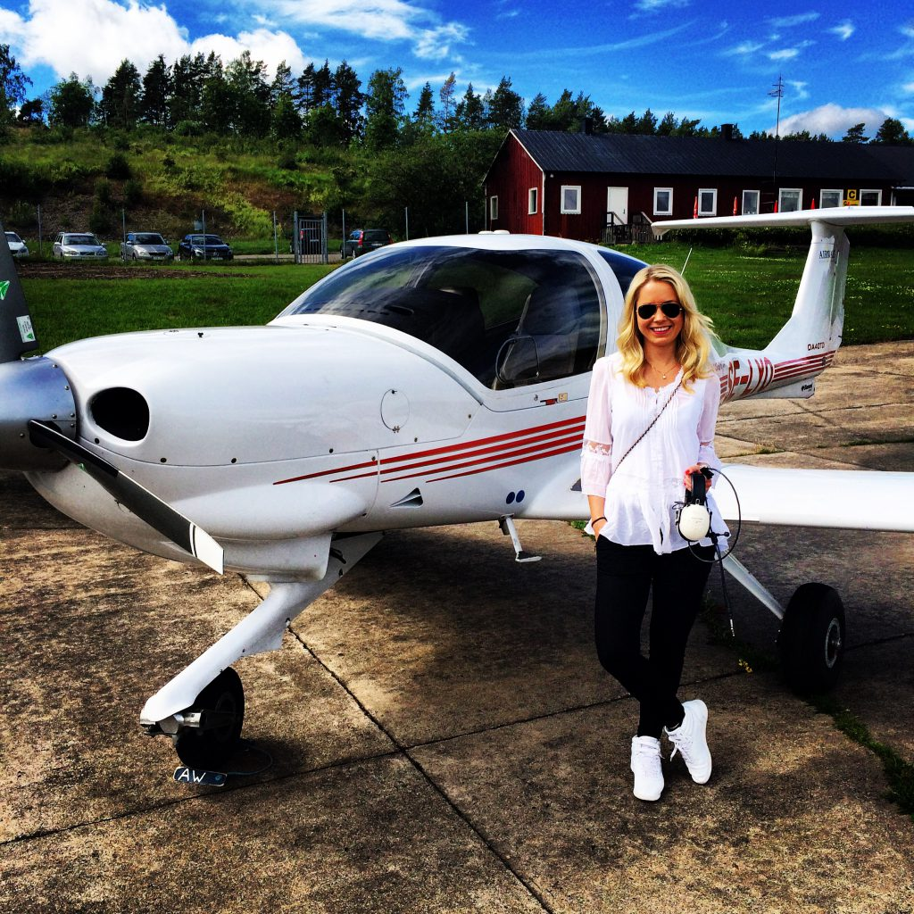 a picture of me in front of a small plane