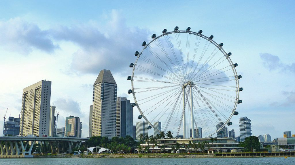 a picture of Singapore Flyer from across the water