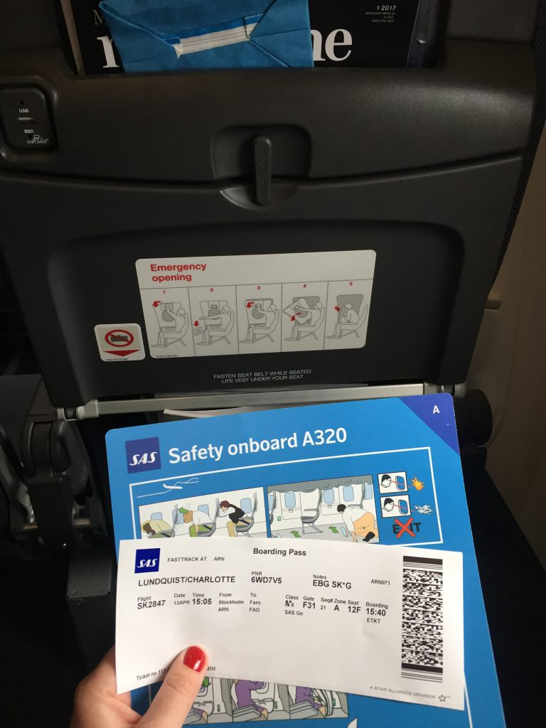 a picture of my boarding pass and safety card on the plane