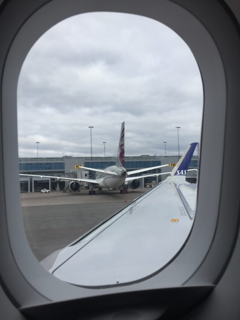 a picture of Qatar airplane parked at arlanda airport