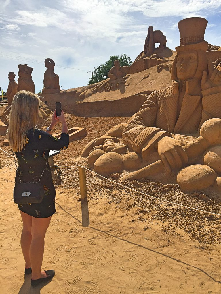 A picture of me taking pictures of mud sculptures