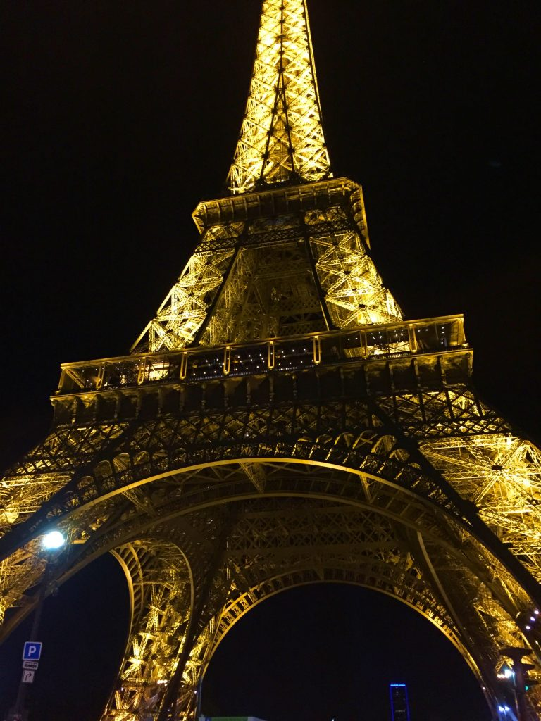 a picture of Eiffel tower at night from its base