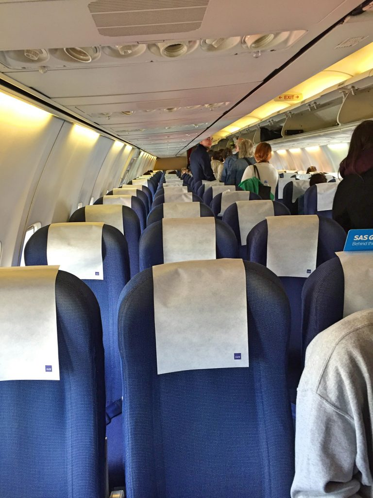a picture of passengers going to their seats