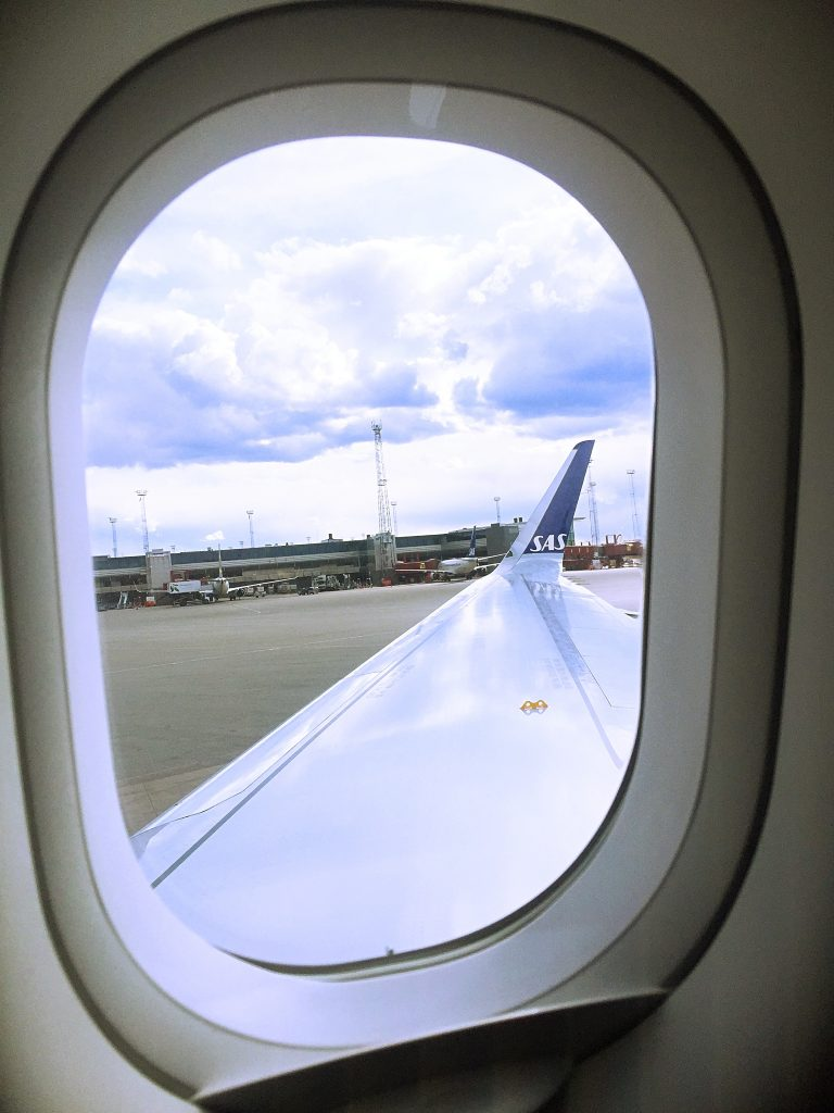 a picture of the wing of the airplane from my window