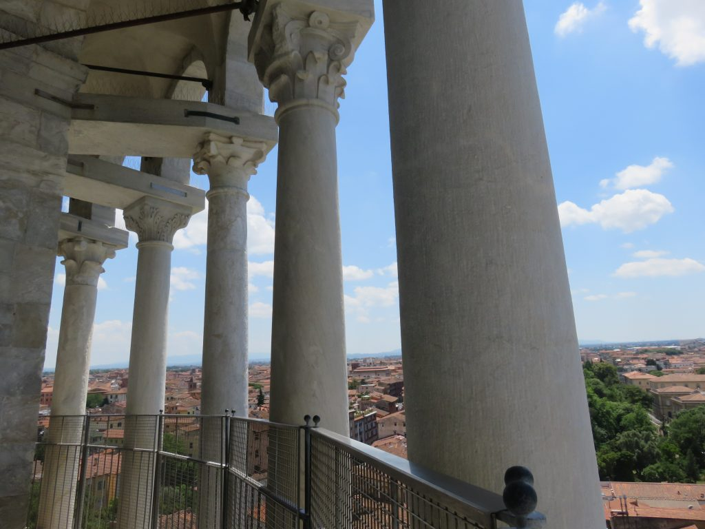 a picture of the pillars on the top floor of the tower