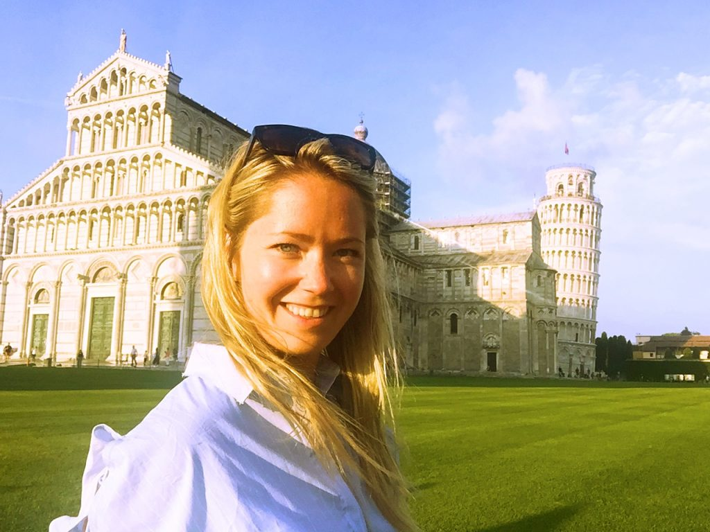 a picture of me in front of the chapel in Pisa