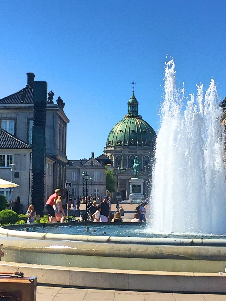 A picture of tourists at the fountain opposite the Copenhagen castle