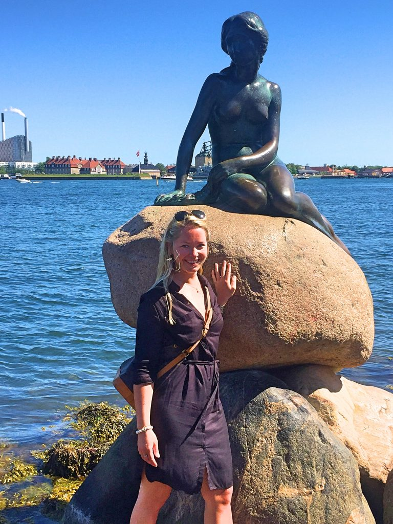 A picture of me with the sculpture of the little mermaid
