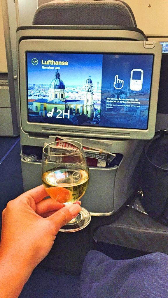 A picture of me holding a glass of champagne after boarding
