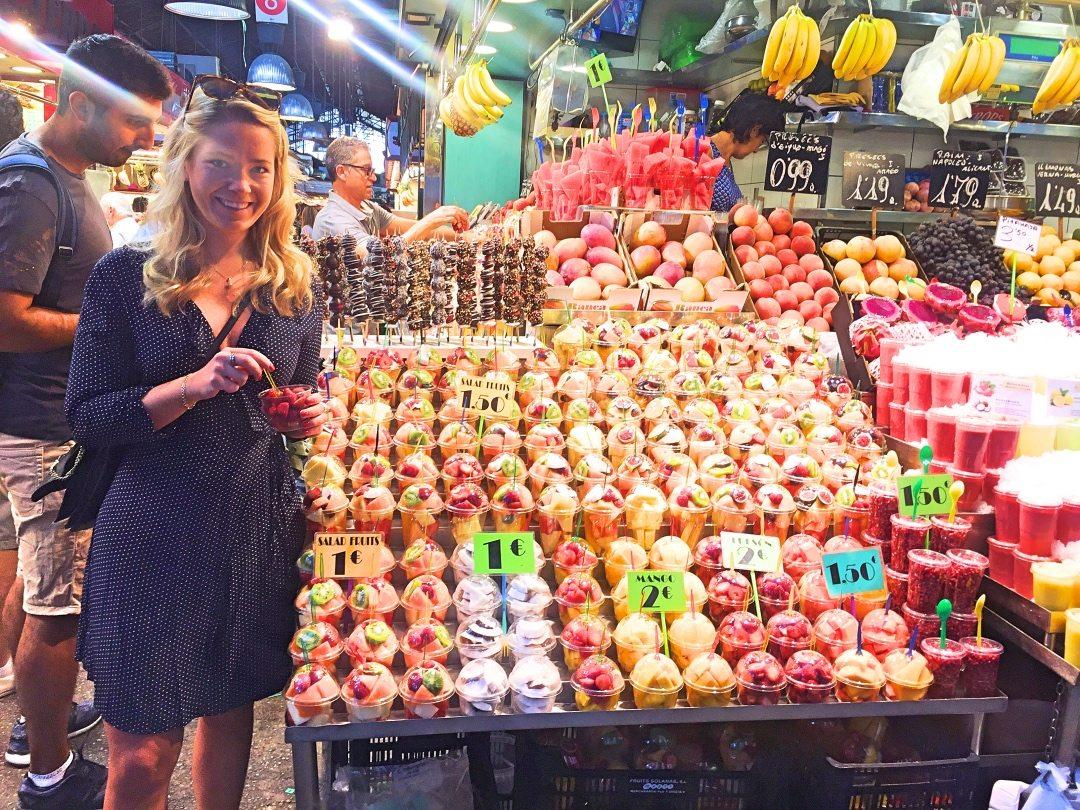 Me eating strawberrie at La Boqueria Barcelona