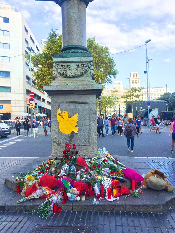 People leaving flowers at a memorial at La Ramblas Barcelona