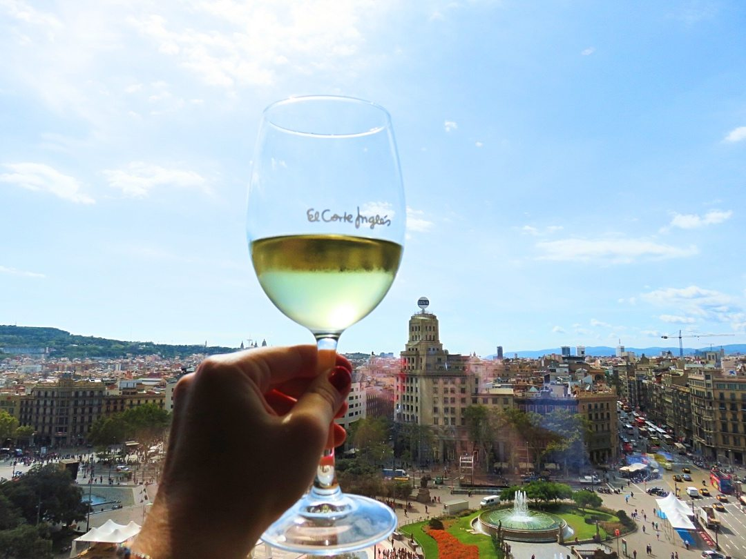 A picture of a glass of wine on the roof of El Corte Ingles Barcelona