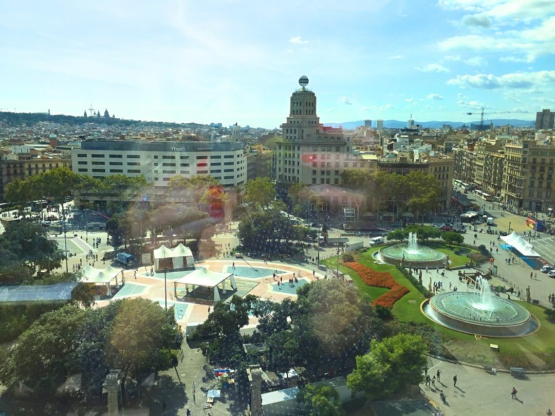 View of the square and fountains from the roof of El Corte Ingles