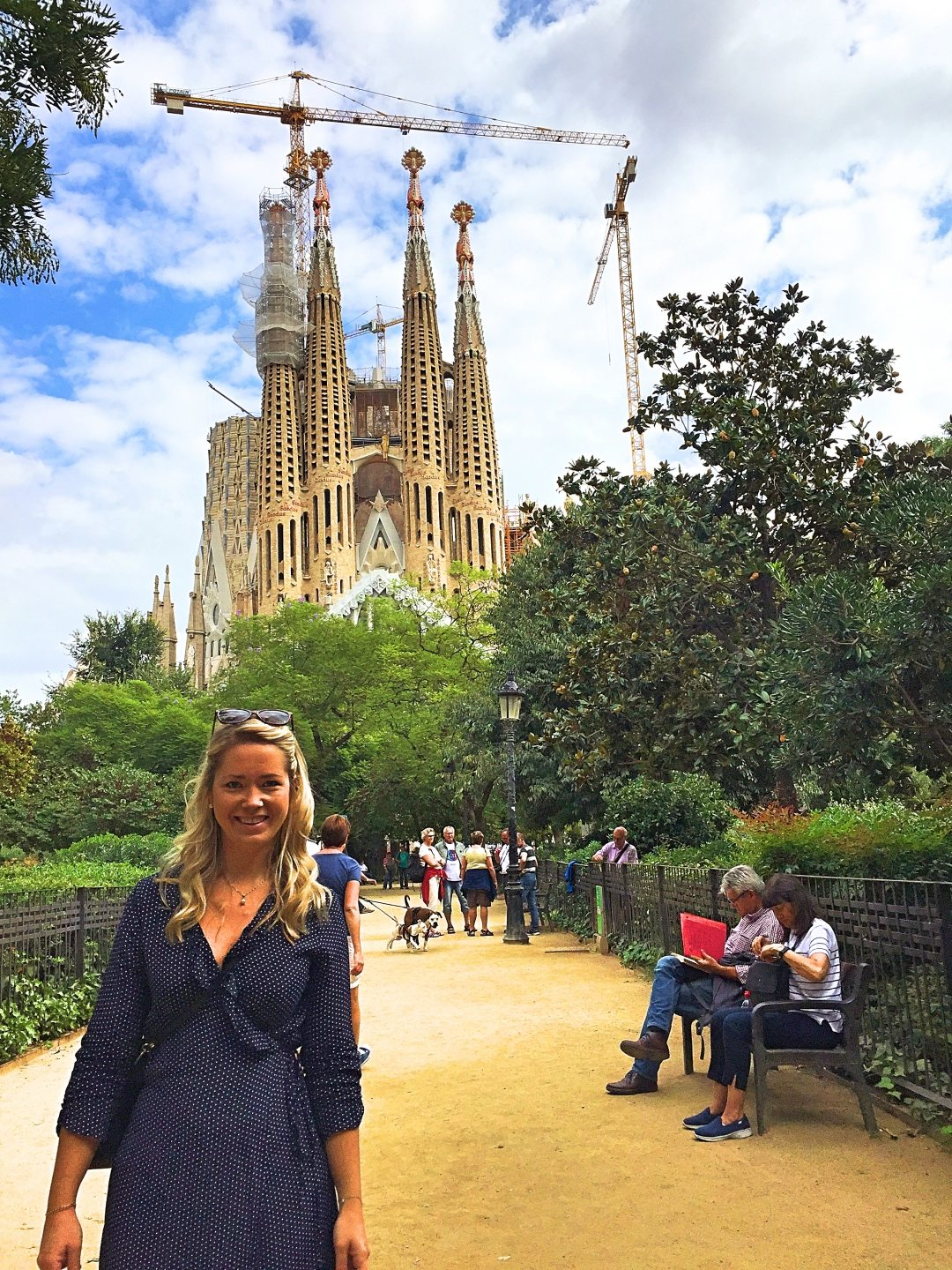 A picture of me with La Sagrada Familia being renovated