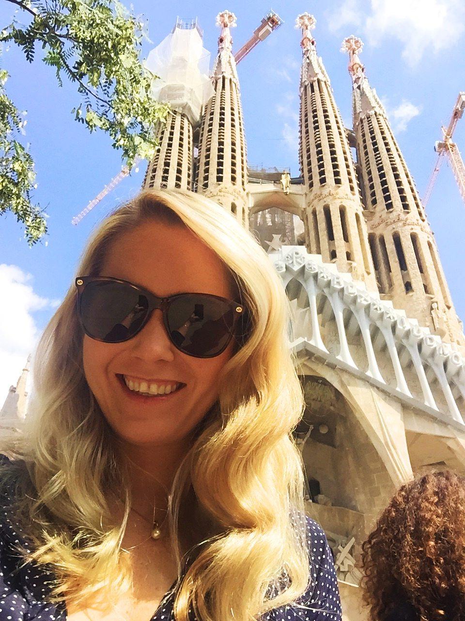 Me taking a selfie in the sun at La Sagrada Familia