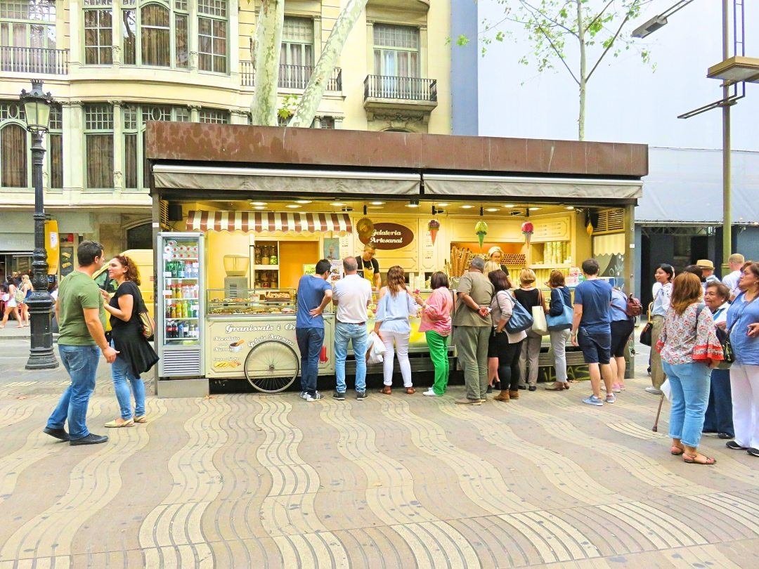 Tourists waiting in line at an ice cream truck at La Rambla Barcelona