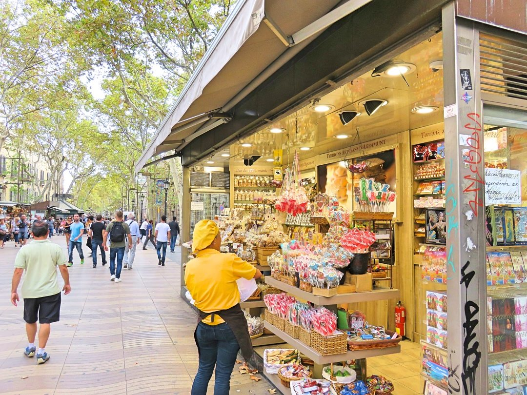 Lady arranging candy at her store at La Rambla Barcelona