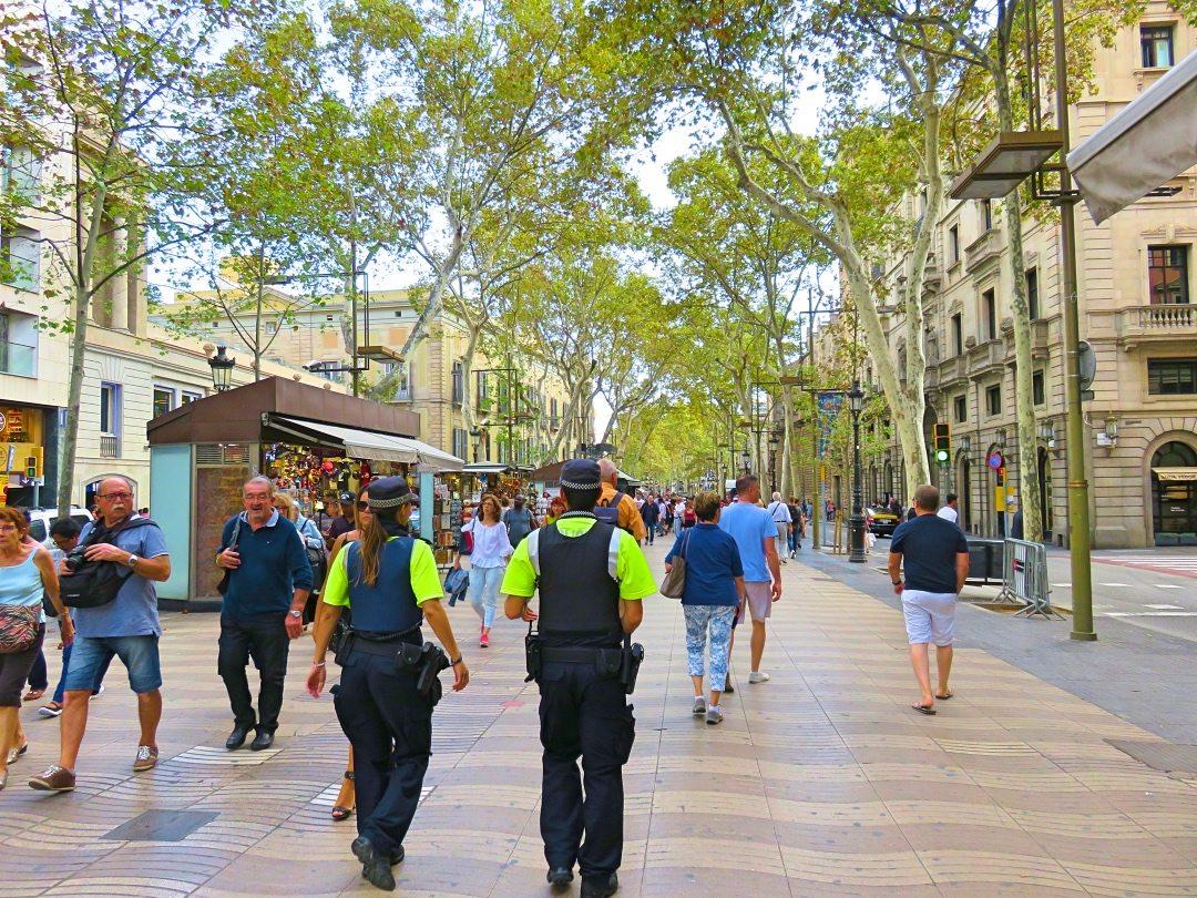 Two policeman walking on duty at La Rambla Barcelona