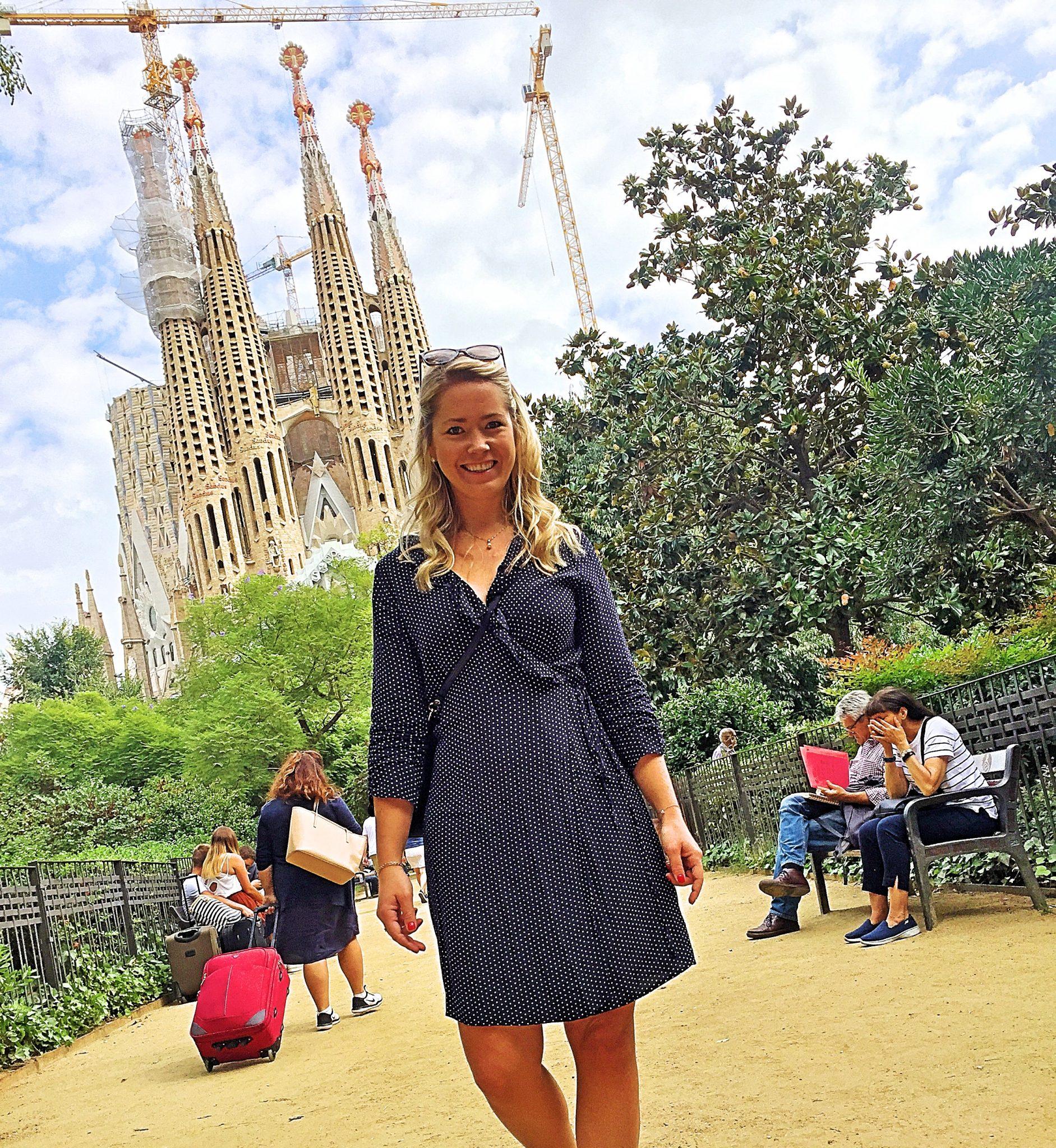 Picture of me with La Sagrada Familia in the back