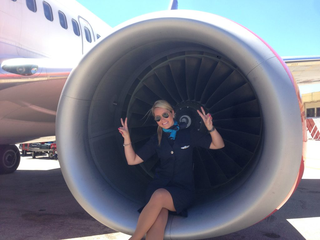 me sitting in the engine of an airplane