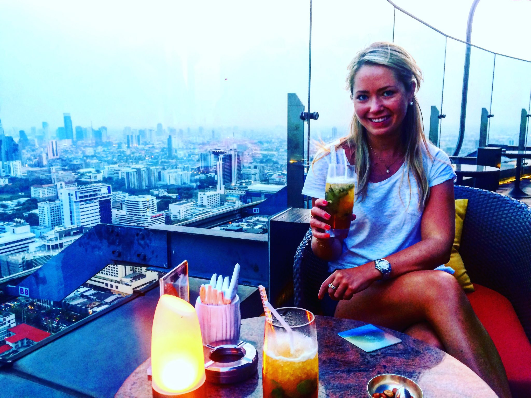 A picture of me having cocktails at the Red Sky rooftop bar