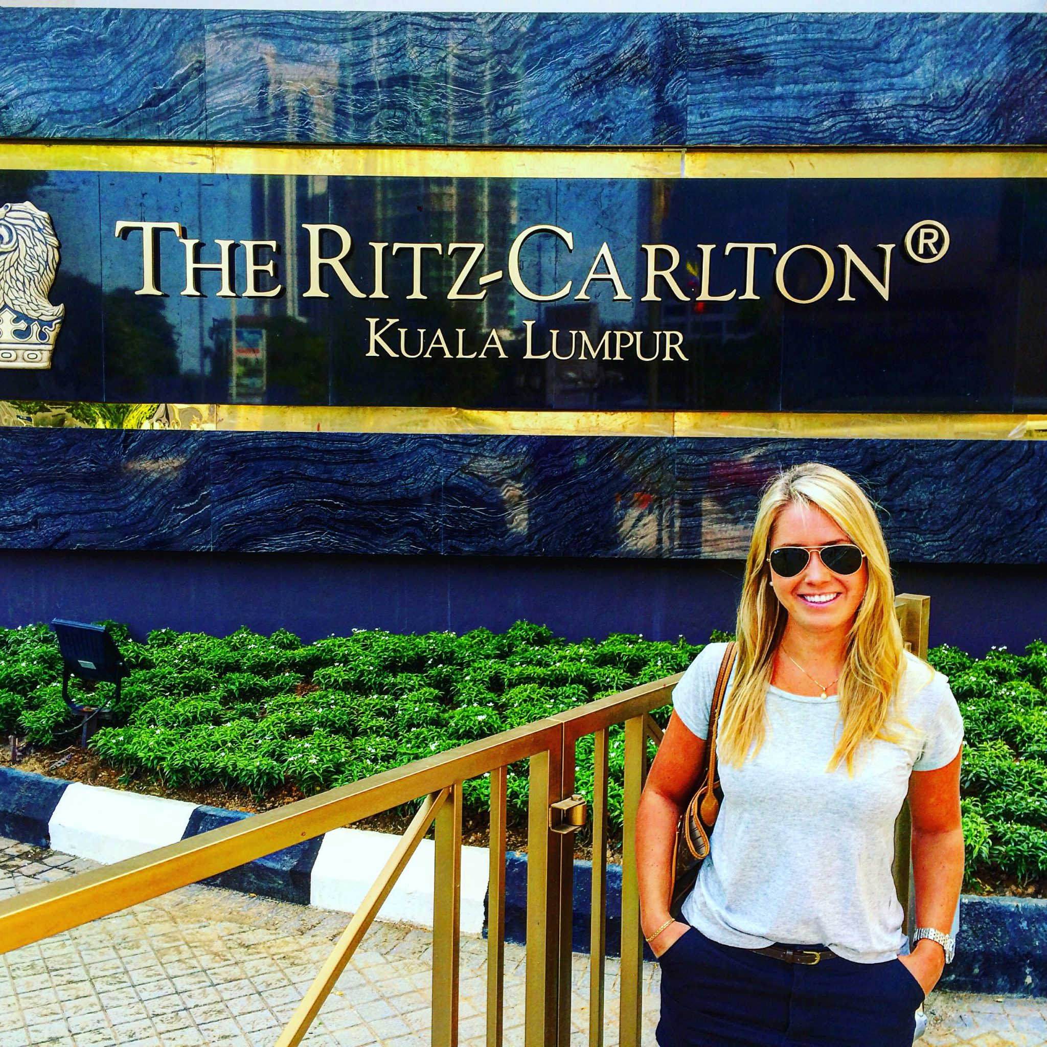 A picture of me standing outside the Ritz Carlton hotel in Kuala Lumpur