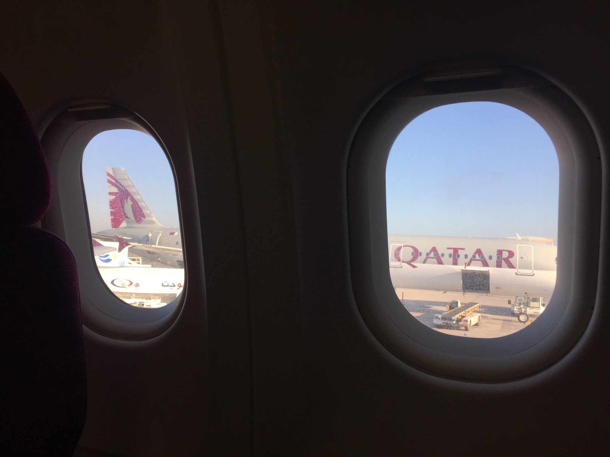 A picture of a Qatar airlines plane parked at Doha airport